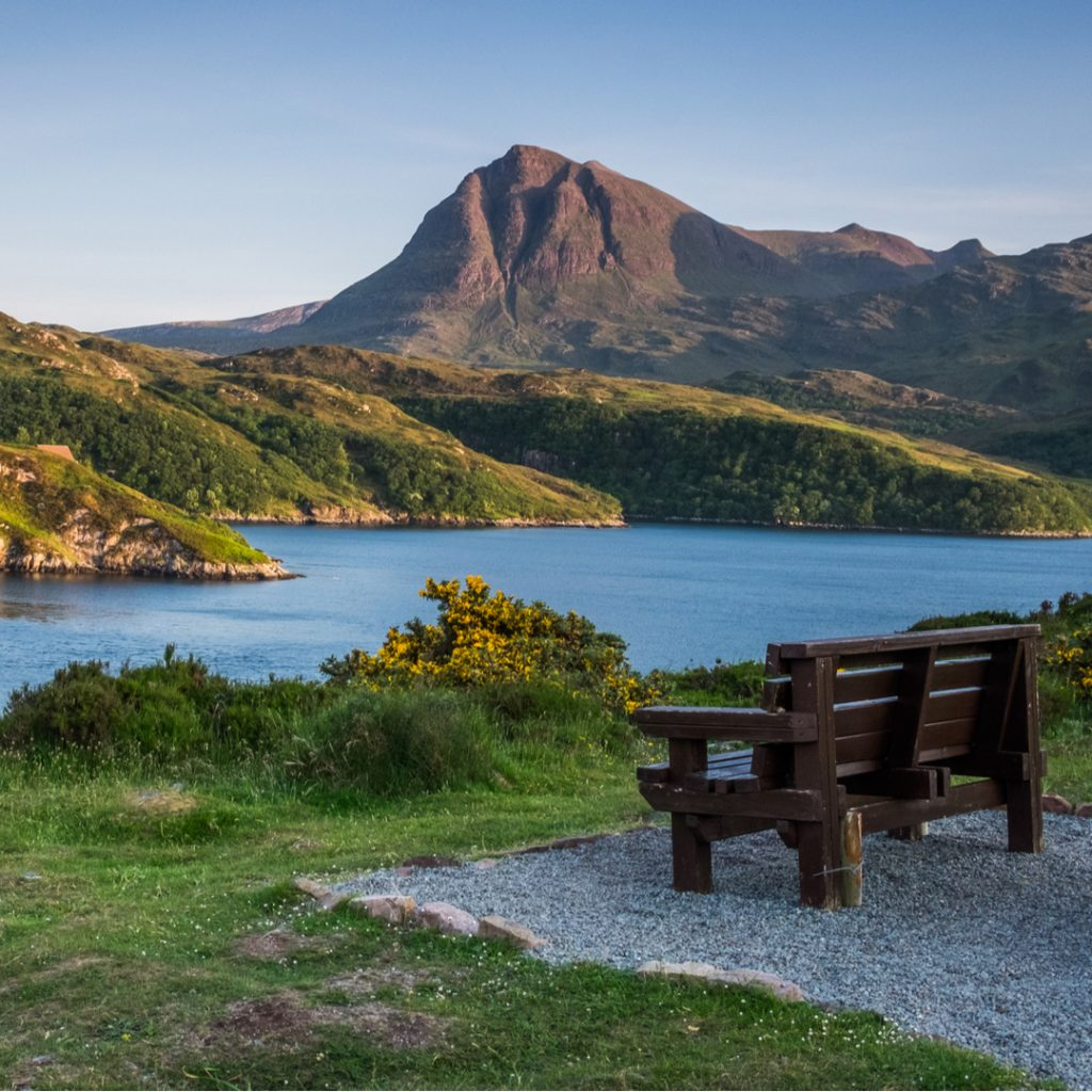 A beautiful Scottish lake and landscape on a sunny day.  DealDash now has auctions for land and lordship packs in Scotland.