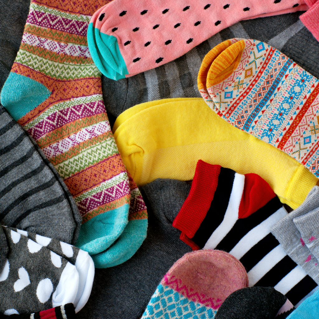 A picture pf brightly colored socks.  Socks always make a great gift or holiday donation.