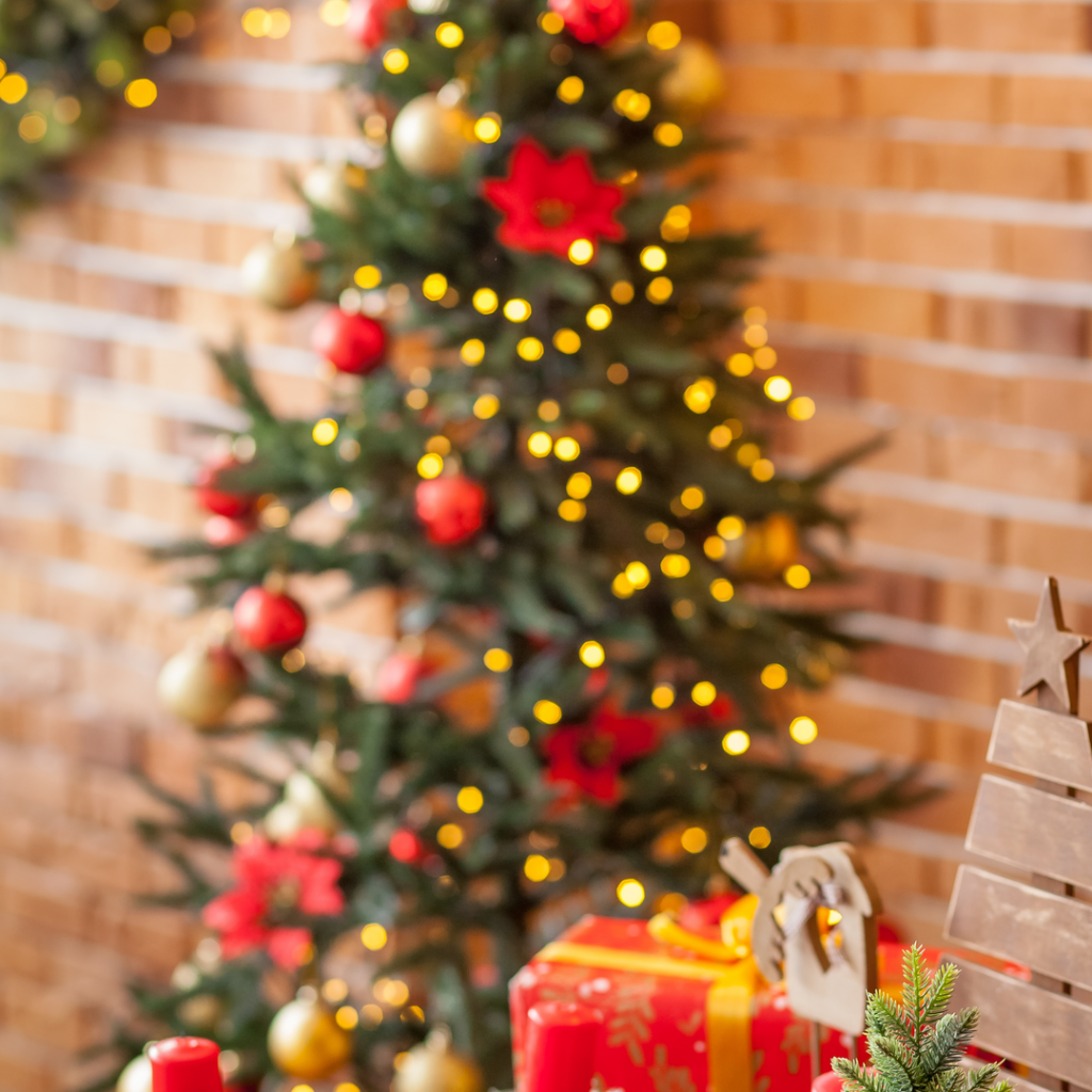 A Christmas tree is decorated with flowers and lights and helps create a special holiday feeling.