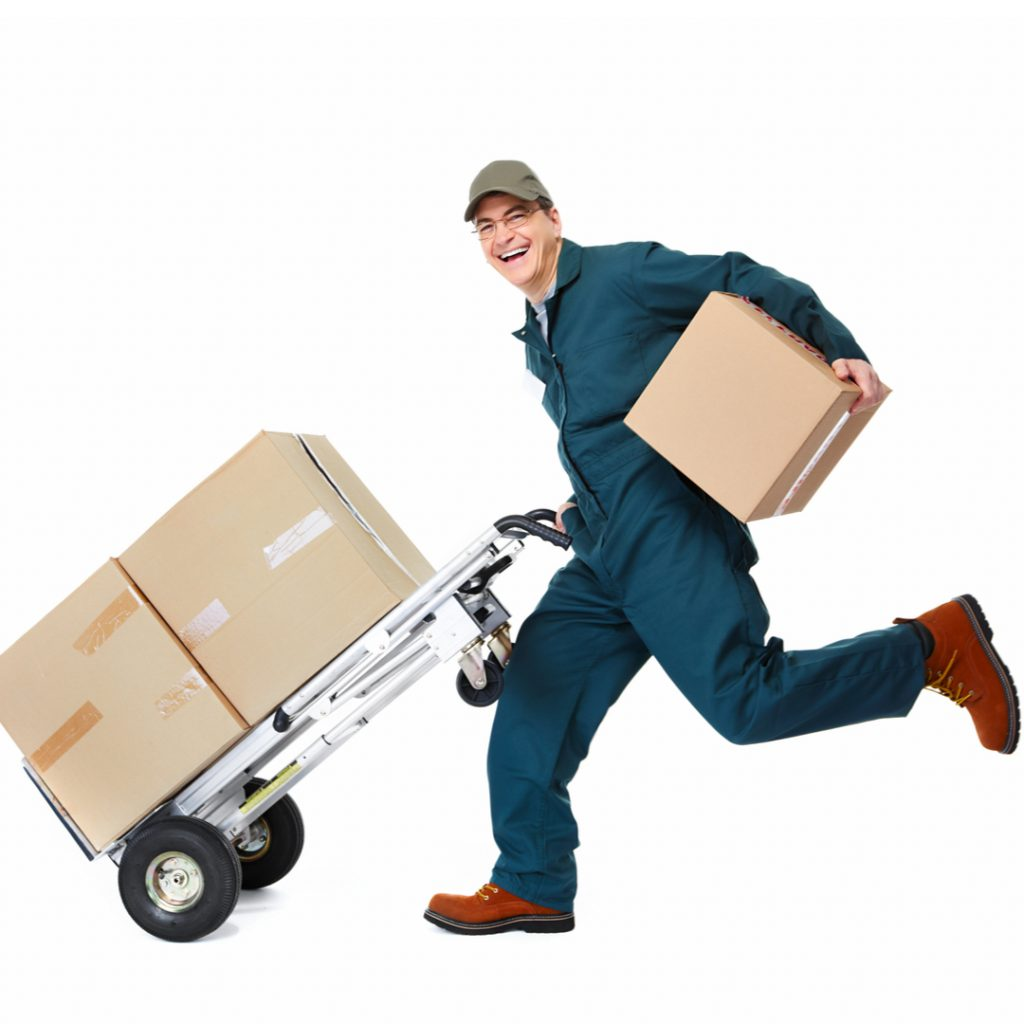 A worker runs to move several boxes out the door of a busy warehouse!