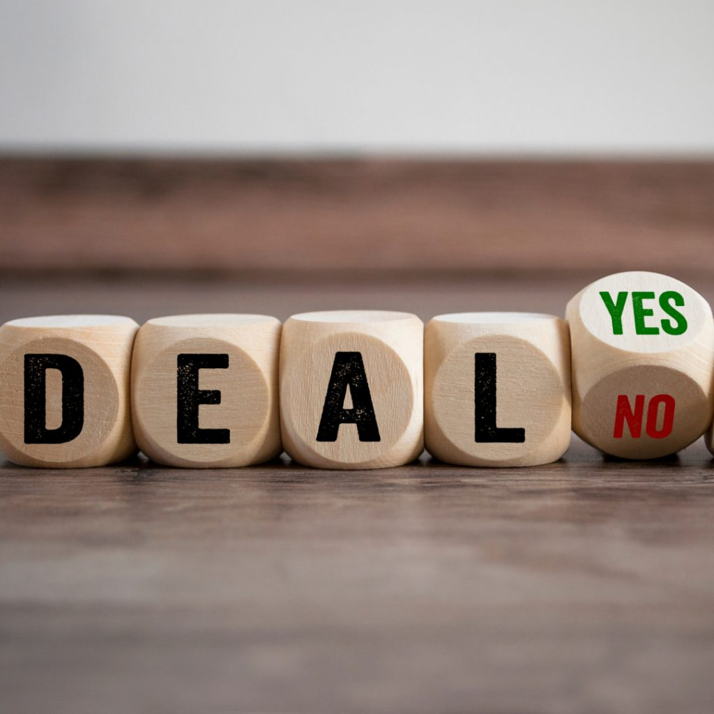 Wooden blocks spell out the word deal and invite you to either accept or decline it.