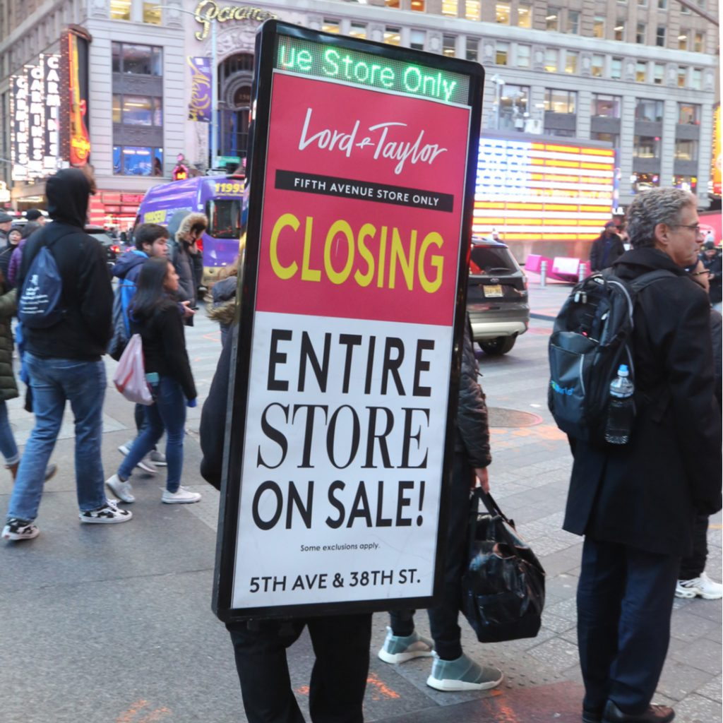Sign spinners are a popular way to advertise special events like inventory liquidation sales.