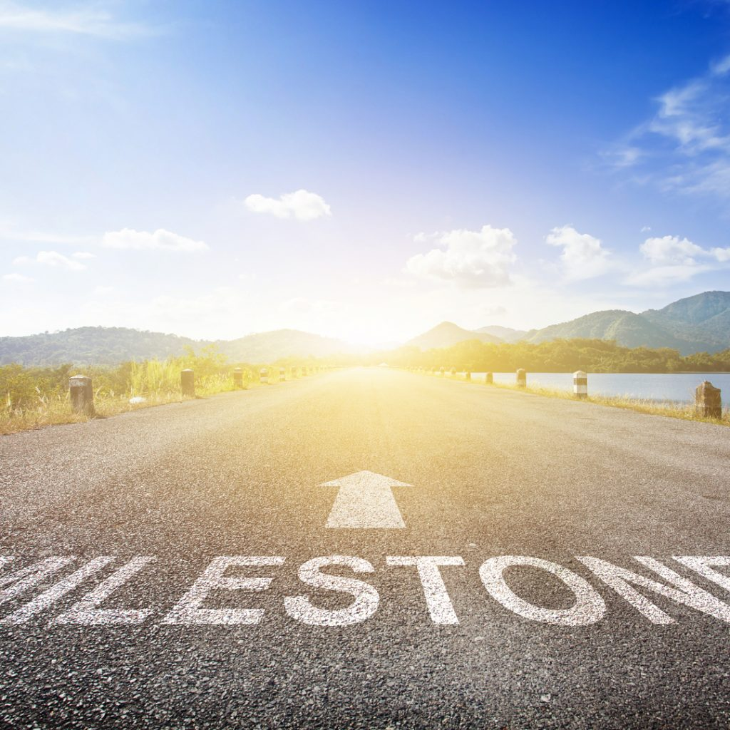 A road leads to a sunny future and personal milestones.